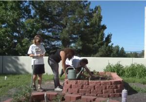 Garden of Youth interns planting at the George Washington HS garden.